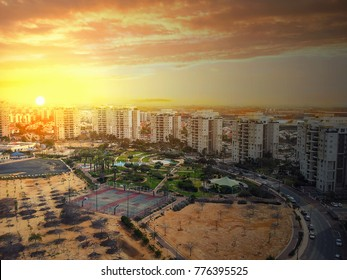 Rishon LeZion, Israel-February 22, 2015: Incredibly beautiful sunrise over Pras Nobel residential district with multi-story condominiums. Big basketball court is seen in the centre