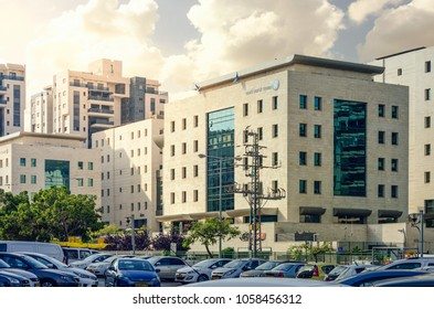 Rishon LeZion, Israel-June 17, 2017: 5 story office building of National Insurance Institute. The building face with yellow stone tiles each side of the building has a central leaded glass section.