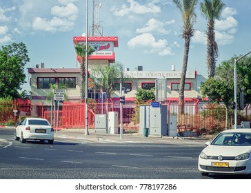 Rishon LeZion, Israel-June 17, 2017:  Fire department headquarter of the city is placed in two story red-white building with watching tower behind wrought iron fence nearby Moshe Dayan Boulevard