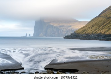 Risin og Kellingin (The Giant and the Witch) sea stacks rocks on the northern coast of the island of Eysturoy in the Faroe Islands close to the town of Eidi. Seen from Tjornuvik, Streymoy island.