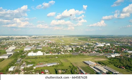 Rising aerial shot of commercial airplane taking off from an international airport