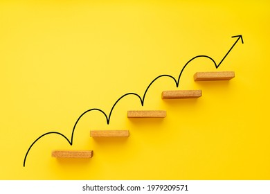Rising arrow on staircase on yellow background. Growth, increasing business, success process concept. Copy space