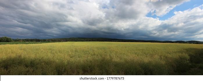 Rising dark clouds above farmland in Bad Münstereifel Germany forming shadows