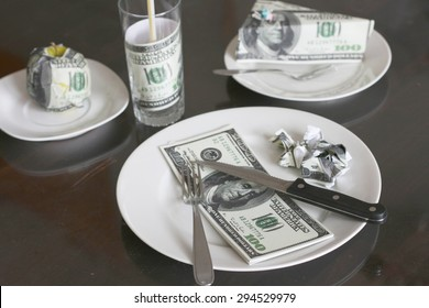 Rising food prices, high cost of living concept, eating foot made out of money - fake 100 dollar bills