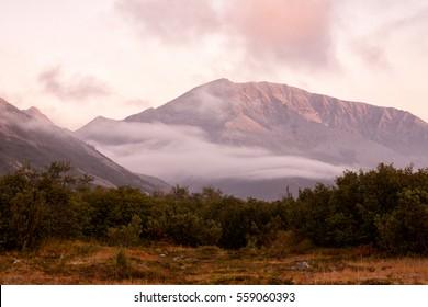 Rising mist in a mountain valley. Peninsula Kony. Magadan Region. Rus