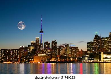 A Rising moon over Toronto, Canada