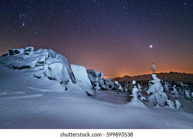The rising of the planet Venus in the night starry sky in the national Park Taganay in the southern Ural mountains.
