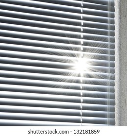 rising sun behind the blinds