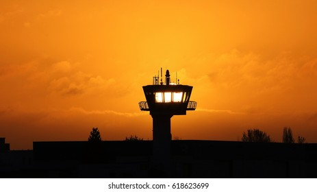 rising sun behind control tower
