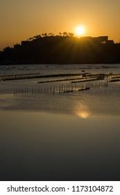 Rising sun at a fishing ground