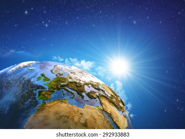 Rising sun over the Earth and its landforms, view of Europe, North Africa and Middle East. Elements of this image furnished by NASA