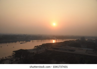 Rising sun over the river - hope of a new day