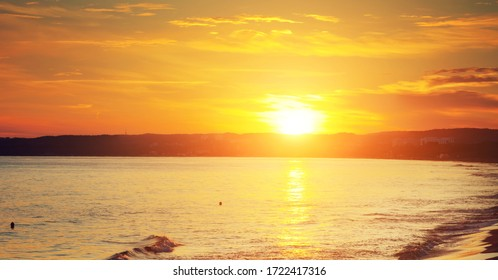 Rising sun over the sea. Sunset on the beach