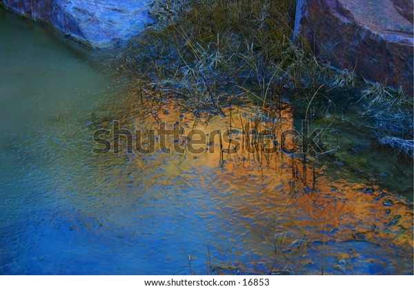 The rising sun reflects off the top of the cliffs above Grape Creek ravine in southern Colorado.