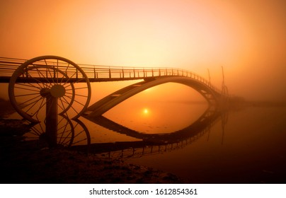 Rising sun through the fog at the Mi-saeng Bridge near Siheung-si, Korea. Mi-saeng is a man from Chinese legend who died in the swollen water trying to keep his promise to meet a girl under a bridge.