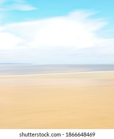 Rising tide, sand, water and sky with blur effect, ICM photography