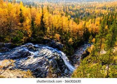 Risjok waterfall in northern taiga forest in the bright sunny afternoon, Hibiny mountains above the Arctic circle, Russia