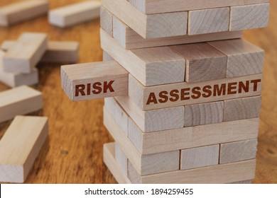 Risk assessment concept using wooden blocks