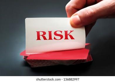 Risk card on black table