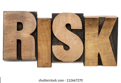 risk - isolated word in vintage letterpress wood type