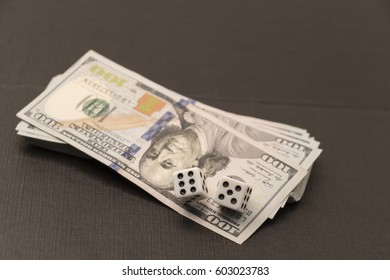 Risk management concept. In a dangerous world, company, workplace or enterprise by reducing costs and liability. Dices lying on dollar note.