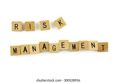 RISK MANAGEMENT word wooden alphabet blocks on white background from top view