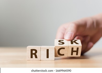 Risk or Rich concept, Hand flip wood cube change the word