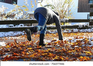 Risk of slipping in autumn and winter. A woman slipped on wet, smooth leaves