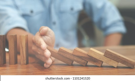 Risk and strategy wealth plan - man hand with wooden block thinking about value investment