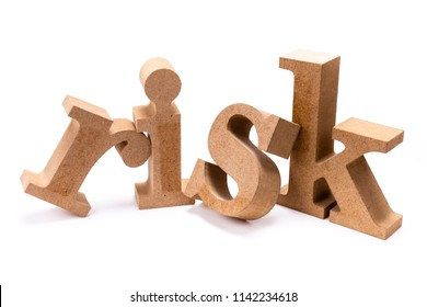 RISK wood word on white background