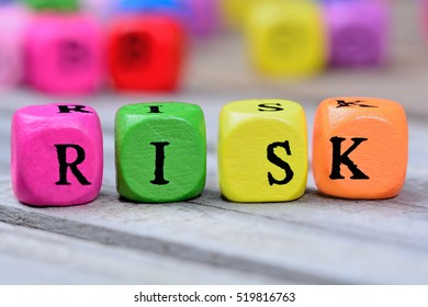 Risk word on grey wooden table