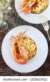 Risoni pasta risotto pasta with shrimps, red crayfish and white wine. Top view