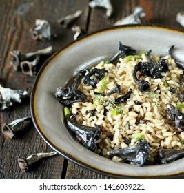 risotto black chanterelle . Black Trumpet mushrooms recipe. Italian food. place for text. copy space.