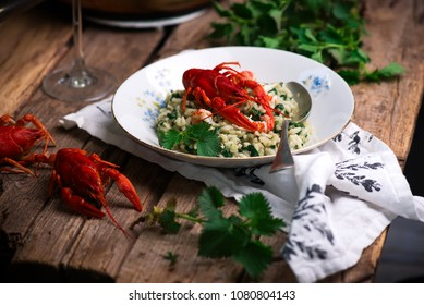 risotto with nettles and crayfish.style rustic.selective focus