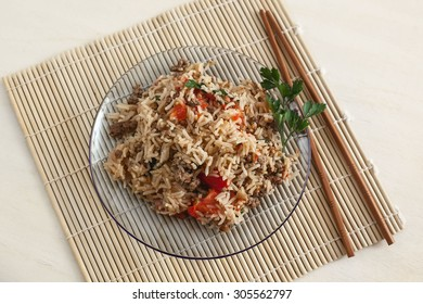 Risotto on a mat with chopsticks rice.