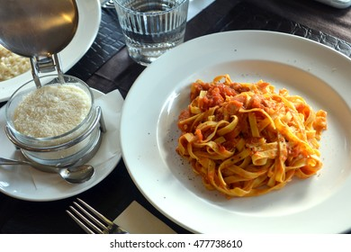 Risotto with tomato sauce and parmesan cheese