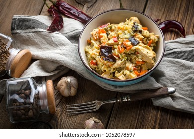 Risotto with vegetables, fried chicken pieces and mushrooms. Selective focus.