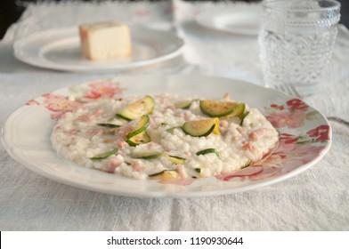 risotto with zucchini, pancetta and taleggio cheese,italy