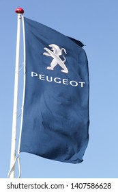 Risskov, Denmark - May 11, 2019: Peugeot logo on a flag. Peugeot is a French cars brand, part of PSA Peugeot Citroen group  and Peugeot company was founded in 1810