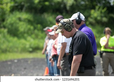 RITTMAN, OH - JUNE 19, 2014. A Sidney, OH middle school Vice-Principal readies himself on the firing line.