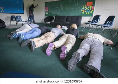 RITTMAN, OH - JUNE 20, 2014. School employees play dead on the floor during an active shooter mock scenario.