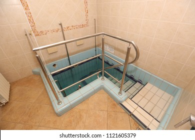 """Ritual bath used for spiritual purification. Blessing on the wall in Hebrew translates: Blessed are you Lord for the commandment of immersion"""""""