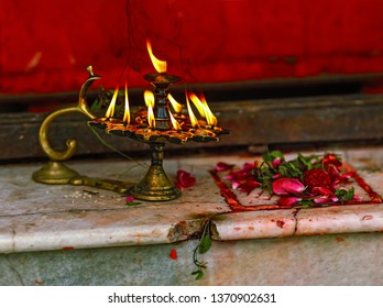 A ritual with candles and flower petals