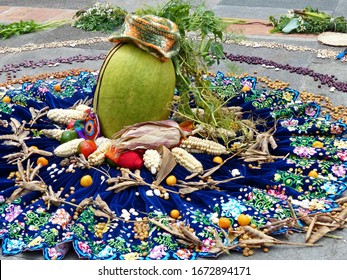 Ritual Chacana or Ceremony in homage to Pachamama (Mother Earth) is an aboriginal ritual of the indigenous peoples of central Andes. Beans, corn, fruit, tomatoes, pumpkin on the embroidered skirt