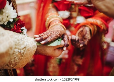Ritual with coconut leaves during traditional Hindu wedding ceremony