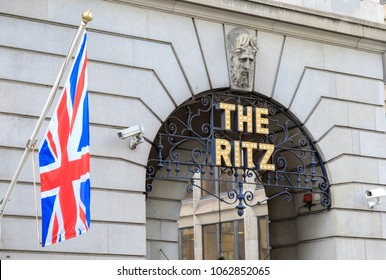 The Ritz Hotel on Piccadilly in London's West End.  The Ritz is a five star landmark hotel.  The sign is next to a Union Jack or flag flying from the wall.  London, England - 28th February 2018.