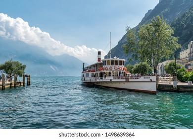 Riva del Garda, Italy -  Aug 1, 2019: An old paddle steamer boat on Lake Garda at Riva del Garda