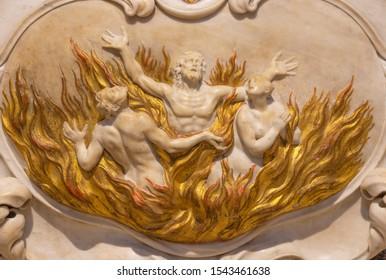 RIVA DEL GARDA, ITALY - JUNE 13, 2019: The baroque marble relief of the souls in purgatory in church Chiesa di Santa Maria Assunta.