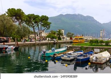 Riva del Garda, Italy - Sep 4, 2019: Tourist boats in Riva del Garda small town.