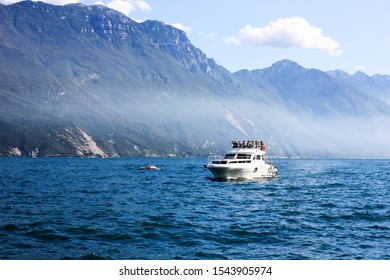Riva del Garda, Province of Trento, Italy, September 2019 : View on a lake and mountains. Boat on a water